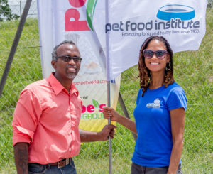 Sandra Kemp, Pet Food Institute representative, pauses with Jared Subhaw, IKC-TT president (left) during the 5th Anniversary Dog Show held in San Fernando, Trinidad. (Photo: Aakiesht Photography)